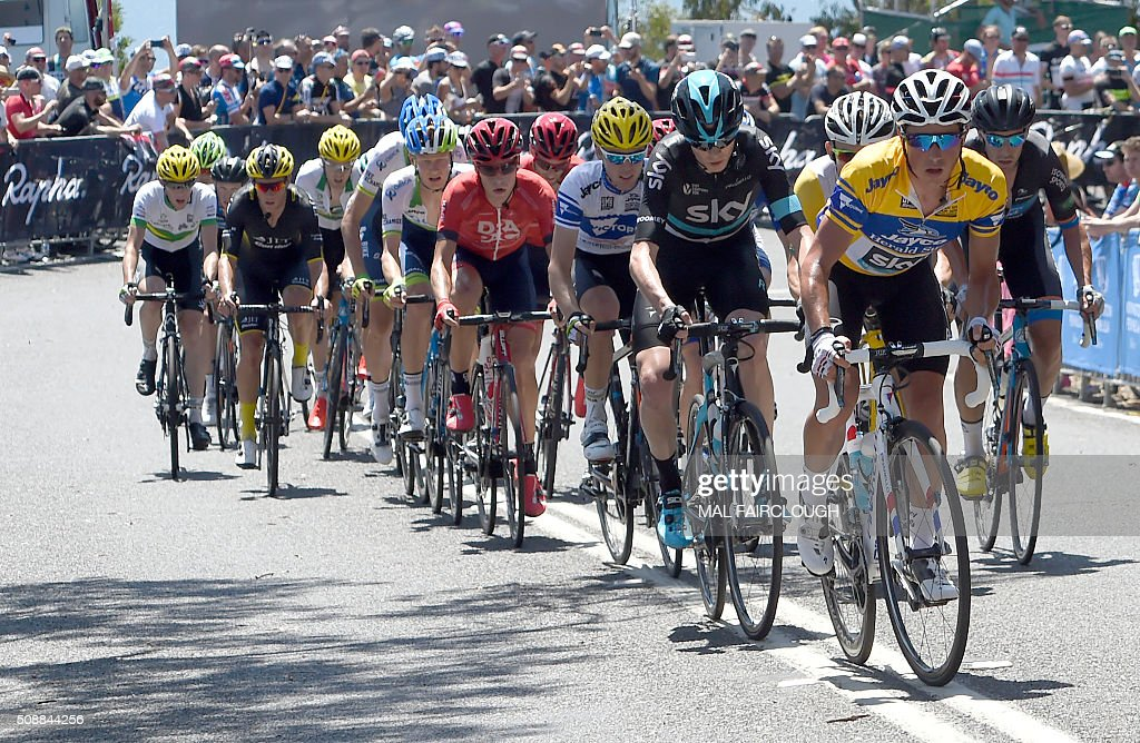 Britain's Chris Froome of Team Sky (2nd L-in black) follows teammate Peter Kennaugh (R) of Britain during stage four of the 2016 Herald Sun Tour cycling race at Arthurs Seat in Victoria on February 7, 2016. AFP PHOTO / MAL FAIRCLOUGH FAIRCLOUGH