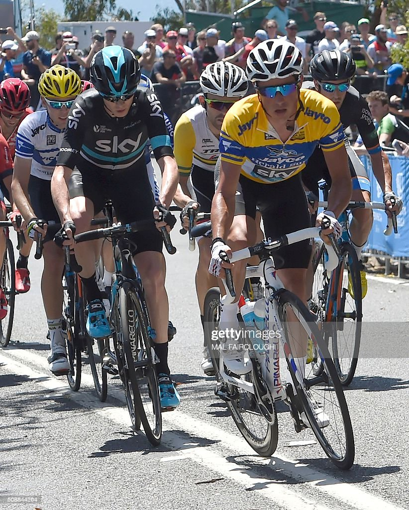 Britain's Chris Froome of Team Sky (front L-in black) follows teammate Peter Kennaugh (R) of Britain during stage four of the 2016 Herald Sun Tour cycling race at Arthurs Seat in Victoria on February 7, 2016. AFP PHOTO / MAL FAIRCLOUGH FAIRCLOUGH