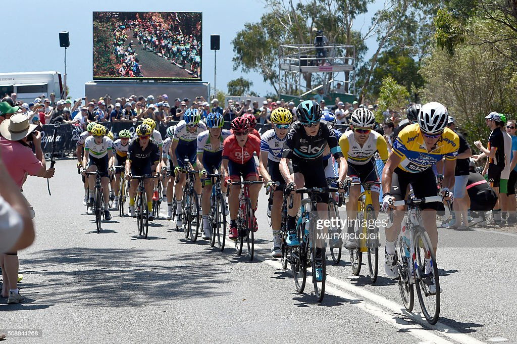 Britain's Chris Froome of Team Sky (2nd R-in black) follows teammate Peter Kennaugh (R) of Britain during stage four of the 2016 Herald Sun Tour cycling race at Arthurs Seat in Victoria on February 7, 2016. AFP PHOTO / MAL FAIRCLOUGH FAIRCLOUGH