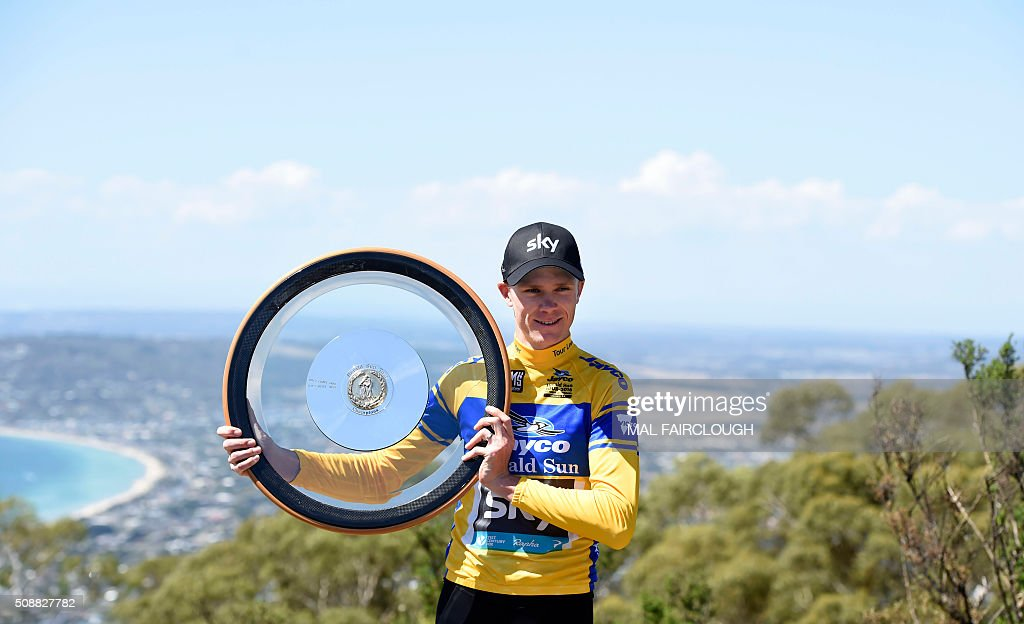 Britain's Chris Froome of Team Sky holds up the trophy after winning stage four to place first as overall leader to win the 2016 Herald Sun Tour cycling race at Arthurs Seat in Victoria on February 7, 2016. AFP PHOTO / MAL FAIRCLOUGH FAIRCLOUGH