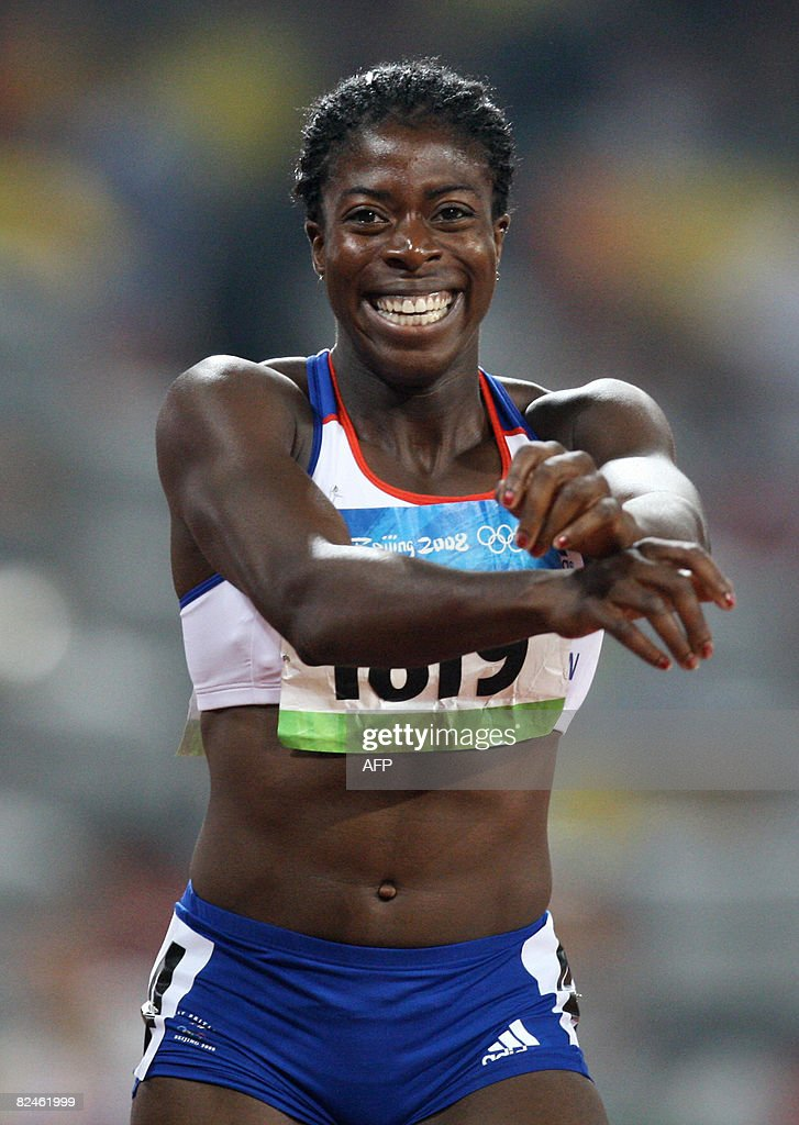 Britain's <a gi-track='captionPersonalityLinkClicked' href=/galleries/search?phrase=Christine+Ohuruogu&family=editorial&specificpeople=703549 ng-click='$event.stopPropagation()'>Christine Ohuruogu</a> celebrates winning gold in the women's 400m final at the 'Bird's Nest' National Stadium during the 2008 Beijing Olympic Games on August 19, 2008. Ohuruogu won the 400m women's Olympic title in a time of 49.62 seconds. The 24-year-old world champion beat Jamaica's Shericka Williams (49.69sec) while favourite Sanya Richards of the US took bronze (49.93sec).