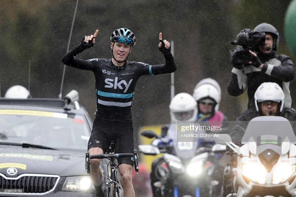 Britain's Christopher Froome of Team Sky celebrates his victory in the fourth stage of the 70th Tour de Romandie UCI World Tour, a 172,7 km race between Conthey to Villars-sur-Ollon, on April 30, 2016 in Villars-sur-Ollon, western Switzerland. / AFP / FABRICE