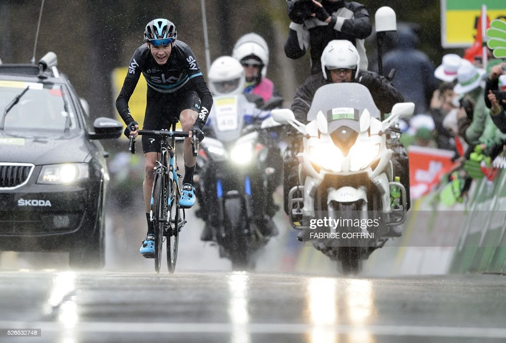 Britain's Christopher Froome of Team Sky jubilates as he wins the fourth stage of the 70th Tour de Romandie UCI World Tour, a 172,7 km race between Conthey to Villars-sur-Ollon, on April 30, 2016 in Villars-sur-Ollon, western Switzerland. / AFP / FABRICE