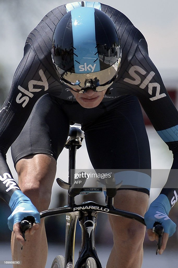 Britain's Christopher Froome sprints at the end of the 32,5 km time-trial of the 65th edition of the Dauphine Criterium cycling race, on June 5, 2013 between Villars-les-Dombes and Parc des Oiseaux (The bird park located in Villars-les-Dombes). AFP PHOTO / JEFF PACHOUD