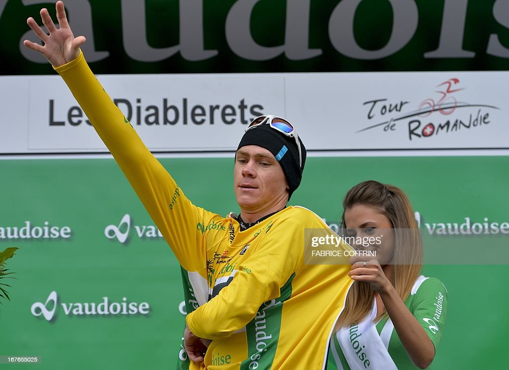 Britain's Christopher Froome wears the overall leader yellow jacket on the podium of the fourth stage of the Tour de Romandie cycling race on April 27, 2013 in Les Diablerets.
