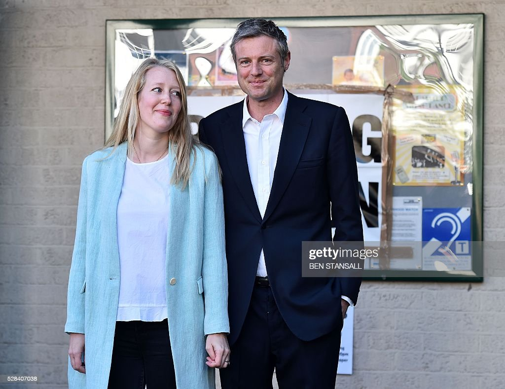 Britain's Conservative party candidate for London Mayor Zac Goldsmith (R) and his wife Alice pose for photographers as they leave a Polling Station in south-west London on May 5, 2016, after casting their votes. Londoners go to the polls on Thursday to elect their new mayor following a bitter campaign between the two leading candidates, Goldsmith, and Labour's Sadiq Khan, that stayed ugly to the very end. / AFP / BEN