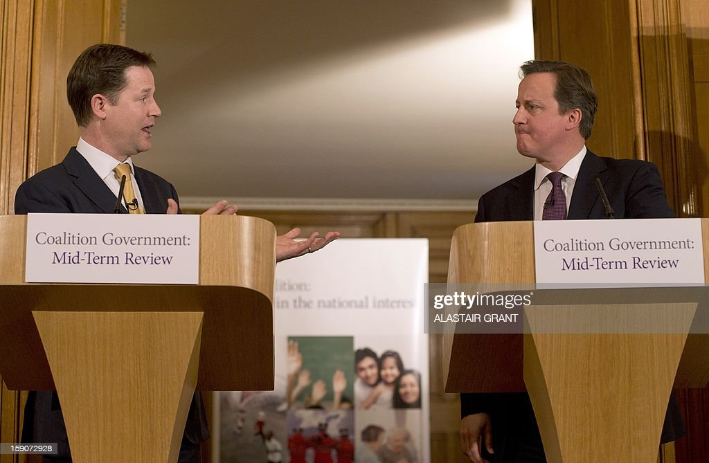 Britain's Conservative Party Prime Minister David Cameron (R) and Liberal Democrat Party Deputy Prime Minister Nick Clegg speak at a press conference inside 10 Downing Street to mark the half-way point in the five-year term of the coalition government in London on January 7, 2013. British Prime Minister David Cameron and his deputy Nick Clegg insisted their coalition would serve its full five years as they pledged fresh reforms to mark the midway point of their government.
