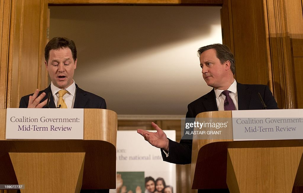 Britain's Conservative Party Prime Minister David Cameron (R) and with Liberal Democrat Party Deputy Prime Minister Nick Clegg react as they answer a question from the media during a joint press conference inside 10 Downing Street to mark the half-way point in the five-year term of the coalition government in London on January 7, 2013. British Prime Minister David Cameron and his deputy Nick Clegg insisted their coalition would serve its full five years as they pledged fresh reforms to mark the midway point of their government.