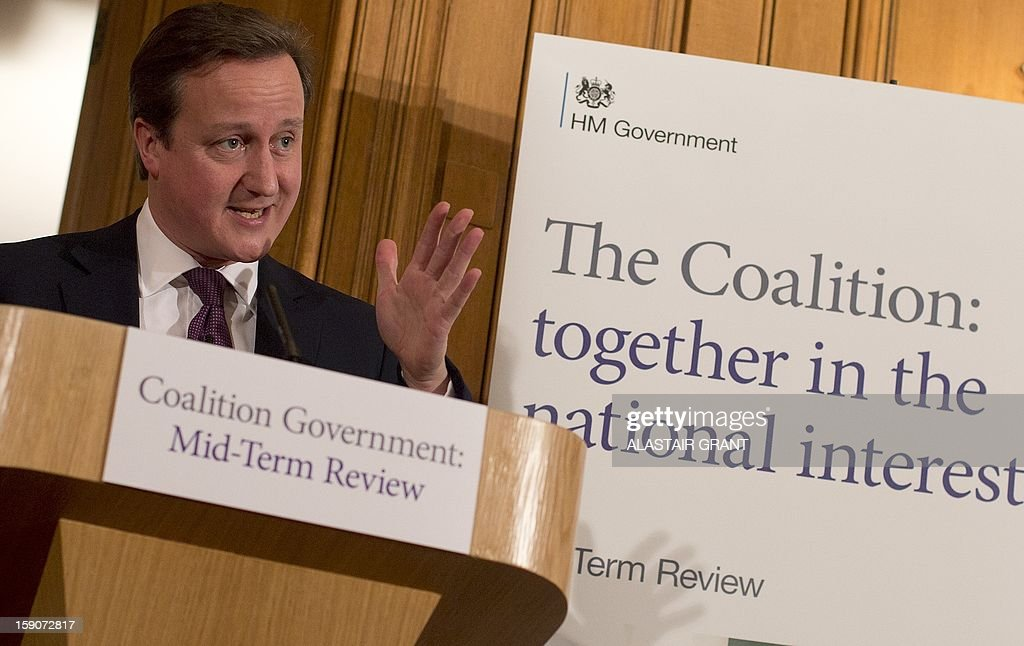 Britain's Conservative Party Prime Minister David Cameron speaks at a press conference inside 10 Downing Street to mark the half-way point in the five-year term of the coalition government in London on January 7, 2013. British Prime Minister David Cameron and his deputy Nick Clegg insisted their coalition would serve its full five years as they pledged fresh reforms to mark the midway point of their government.