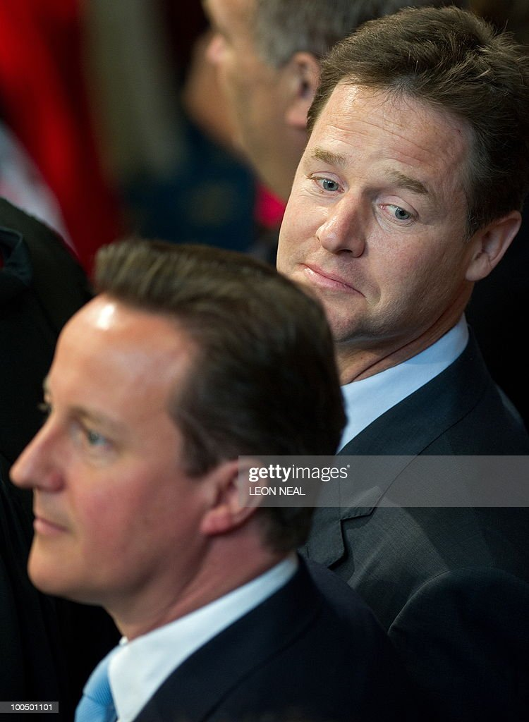 Britain's Conservative Prime Minister, David Cameron (L), and Liberal Democrat Deputy Prime Minister, Nick Clegg wait to leave after attending the State Opening of Parliament, at the Houses of Parliament, in Westminster, central London on May 25, 2010. Britain's Queen Elizabeth II set out the new coalition government's legislative programme on Tuesday in a ceremony of pomp and history following the closest general election for decades. AFP PHOTO/Leon Neal/Pool