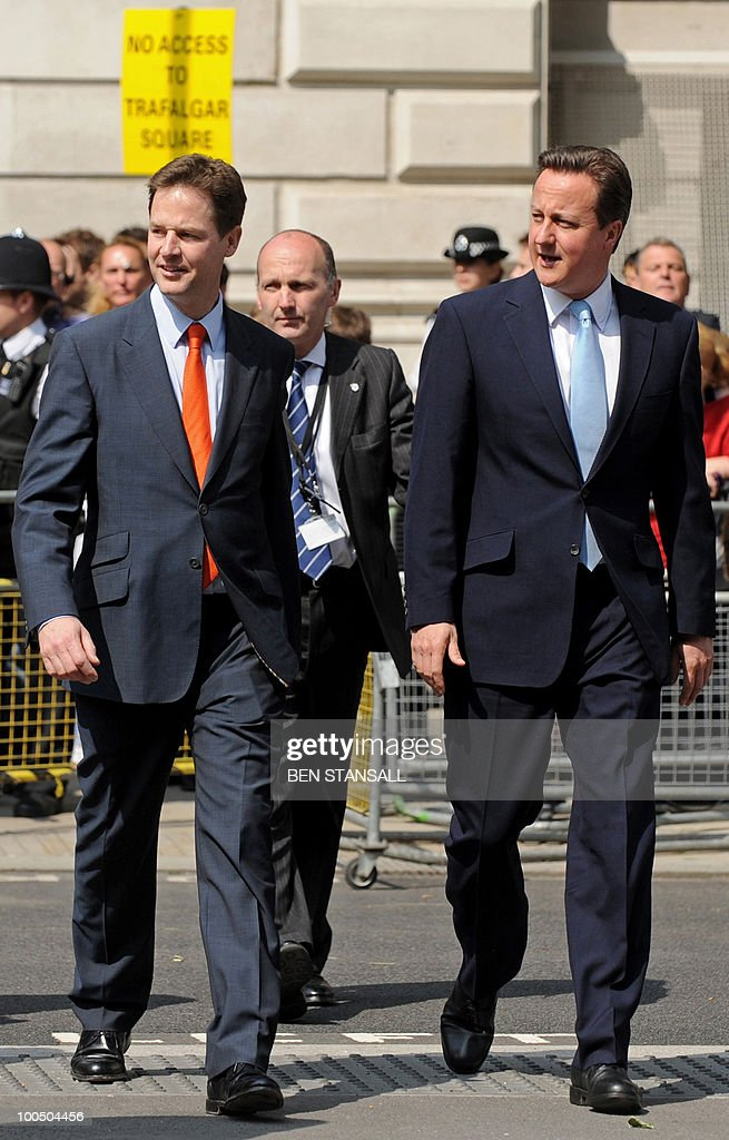 S BYLINE Britain's Conservative Prime Minister, David Cameron (R), and Liberal Democrat Deputy Prime Minister, Nick Clegg (L), walk to the Houses of Parliament for the State Opening of Parliament, in central London on May 25, 2010. Britain's Queen Elizabeth II set out the new coalition government's legislative programme on Tuesday in a ceremony of pomp and history following the closest general election for decades. AFP PHOTO/Ben Stansall