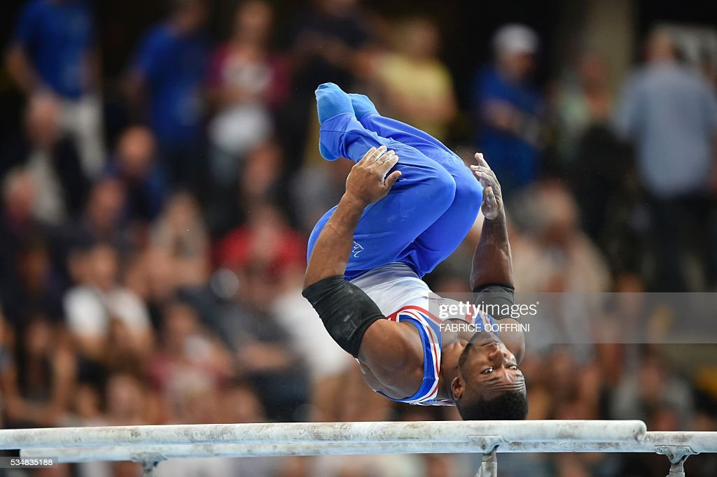 Britain's Courtney Tulloch performs during the Mens Parallel Bars competition of the European Artistic Gymnastics Championships 2016 in Bern, Switzerland on May 28, 2016. / AFP / FABRICE