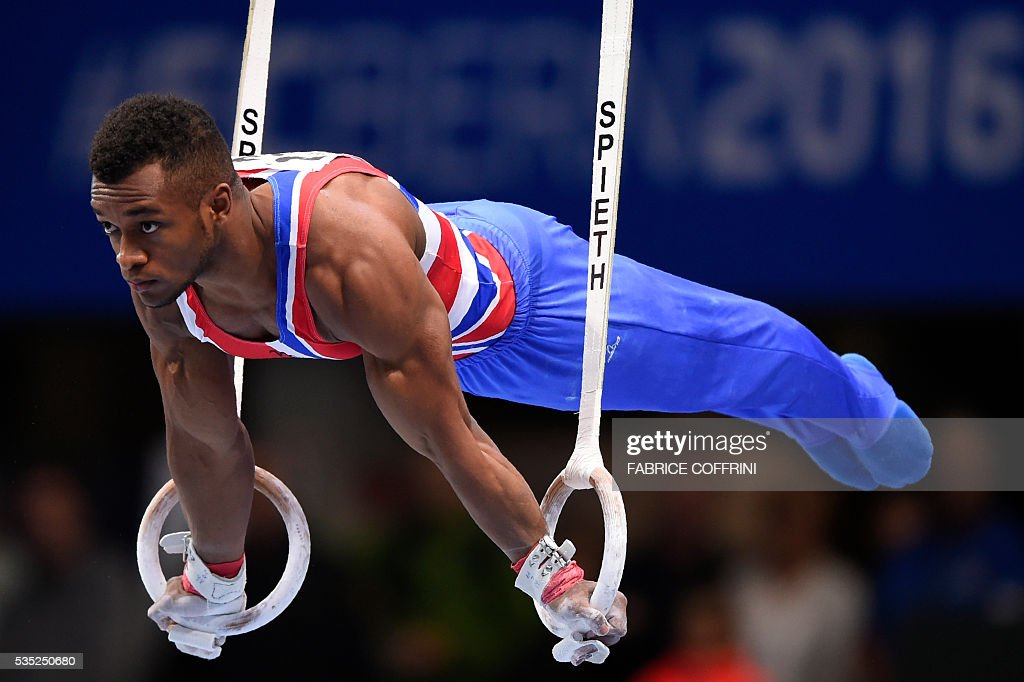 Britains Courtney Tulloch performs during the Mens Rings competition of the European Artistic Gymnastics Championships 2016 in Bern, Switzerland on May 29, 2016. / AFP / FABRICE