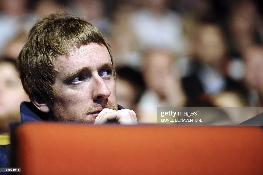Britain's cyclist Bradley Wiggins listens during a press conference to unveil the 2013 cycling classic Tour de France route on October 24, 2012 in Paris. This 100th edition of the Tour will take place from June 29 to July 21 and will start in Corsica for the first time in it's history.