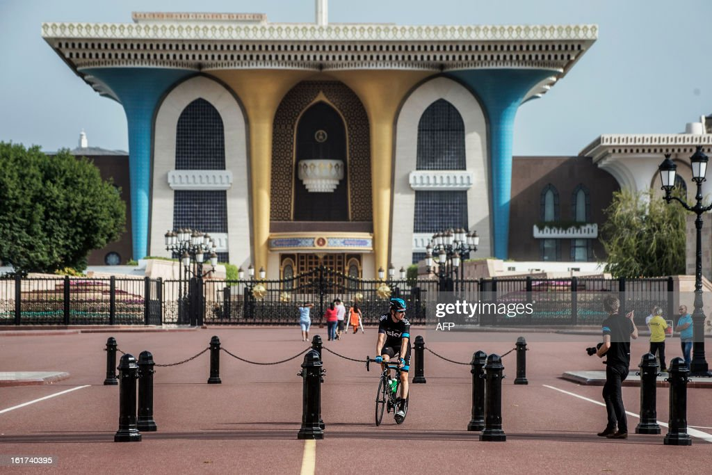 Britain's cyclist Bradley Wiggins of Sky Procycling Team warms up in front of the Al Alam Palace before the start of the fifth stage of the cycling Tour of Oman on February 15, 2013, in the Omani capital Muscat. The fifth stage is a 144km ride from Al Alam Palace in Muscat to the Ministry of Housing in Boshar. AFP PHOTO / JEFF PACHOUD