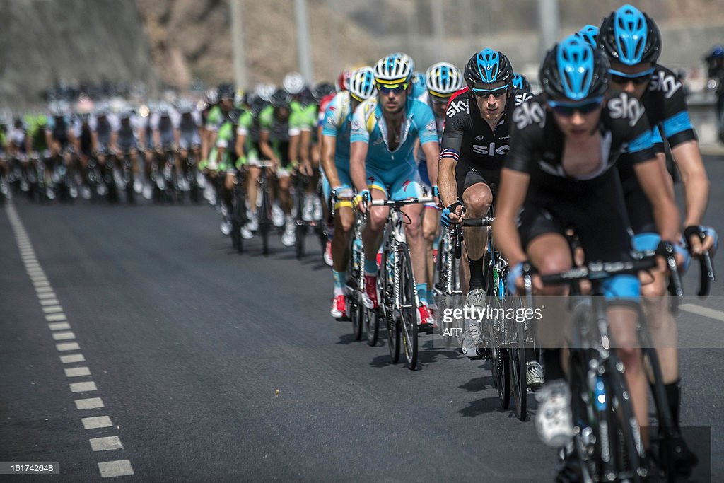 Britain's cyclist Bradley Wiggins (2ndR) rides with the pack during the fifth stage of the cycling Tour of Oman on February 15, 2013, in Oman. The fifth stage is a 144km ride from Al Alam Palace in Muscat to the Ministry of Housing in Boshar.