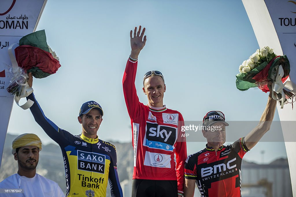 Britain's cyclist of Sky Procycling Team Christopher Froome (L), Spain's Alberto Contador of Saxo-Tinkoff team (L) and Australian Cadel Evans of BMC Racing team (R) wave on the podium at the end of the sixth and last stage of the cycling Tour of Oman, on February 16, 2013, in the Omani capital Muscat. The final stage was a 144km ride from Hawit Nagam park in the south of the emirate to Muscat along the Matrah corniche. Froome won the Oman Tour ahead of Contador and Evans.