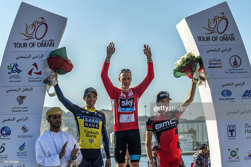 Britain's cyclist of Sky Procycling Team Christopher Froome (C), Spain's Alberto Contador of Saxo-Tinkoff team (L) and Australian Cadel Evans of BMC Racing team (R) wave on the podium at the end of the sixth and last stage of the cycling Tour of Oman, on February 16, 2013, in the Omani capital Muscat. The final stage was a 144km ride from Hawit Nagam park in the south of the emirate to Muscat along the Matrah corniche. Froome won the Oman Tour ahead of Contador and Evans.
