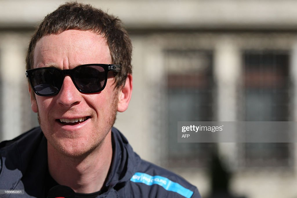 Britain's cyclist Sir Bradley Wiggins of Sky Procycling Team attends cycling road race 'Giro del Trentino' press conference outside the city hall in Lienz, on April 15, 2013. AFP PHOTO / PIERRE TEYSSOT