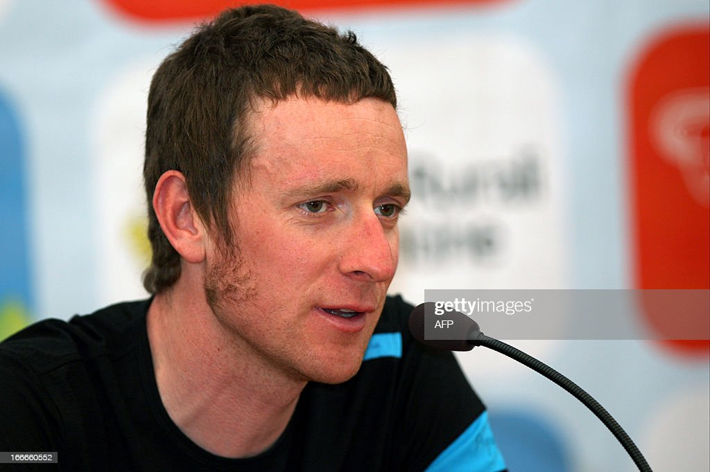 Britain's cyclist Sir Bradley Wiggins of Sky Procycling Team attends cycling road race 'Giro del Trentino' press conference at the city hall in Lienz, on April 15, 2013. AFP PHOTO / PIERRE TEYSSOT