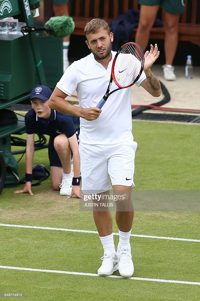 Britain's Daniel Evans celebrates beating Ukraine's Alexandr Dolgopolov in their men's singles second round match on the fourth day of the 2016 Wimbledon Championships at The All England Lawn Tennis Club in Wimbledon, southwest London, on June 30, 2016. / AFP / JUSTIN