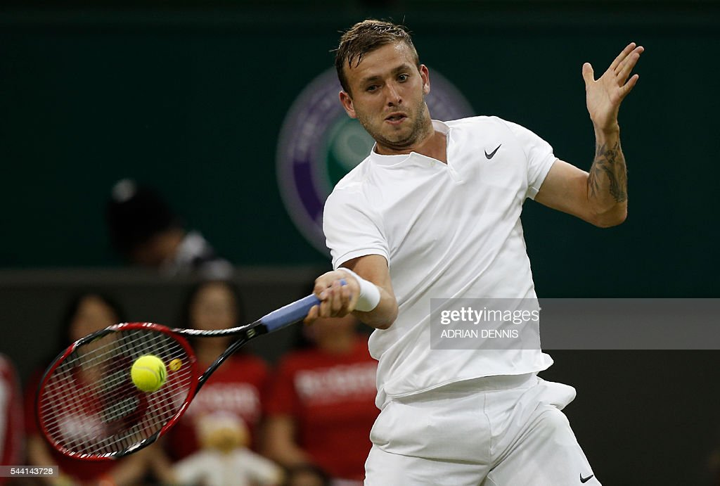 Britain's Daniel Evans returns to Switzerland's Roger Federer during their men's singles third round match on the fifth day of the 2016 Wimbledon Championships at The All England Lawn Tennis Club in Wimbledon, southwest London, on July 1, 2016. / AFP / ADRIAN