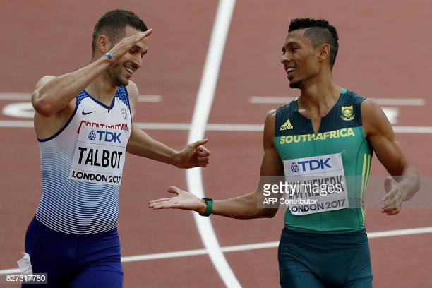 Britain's Daniel Talbot and South Africa's Wayde Van Niekerk react as they come across the line together in a heat of the men's 200m athletics event...
