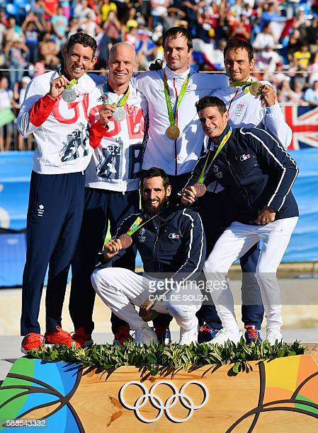 Britain's David Florence and Richard Hounslow Slovakia's Ladislav and Peter Skantar and France's Gauthier Klauss and Matthieu Peche celebrate with...