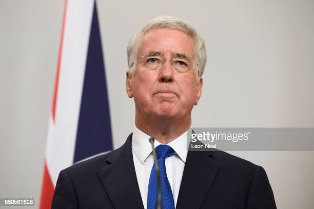 Britain's Defence Secretary Michael Fallon addresses members of the media during a joint UK/Poland press conference in the Foreign and Commonwealth...