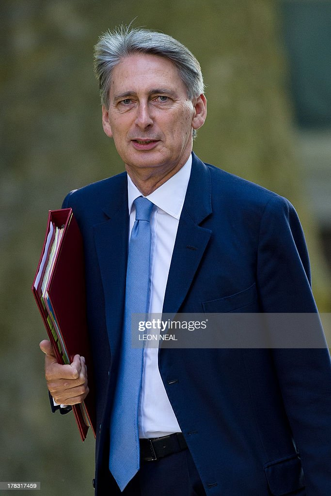 Britain's Defence Secretary Philip Hammond arrives at 10 Downing Street in central London on August 29, 2013 ahead of a Cabinet meeting to discuss a response to Syria following chemical attacks that Britain believe were launched by the Syrian regime. British lawmakers were on August 29, set to vote on Britain's response to chemical weapons attacks in Syria -- but any military action will require a second parliamentary vote.