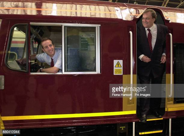 Britain's Deputy Prime Minister John Prescott jokes with train driver Andrew Clasby as he marks the arrival of the 250th class 66 locomotive to enter...