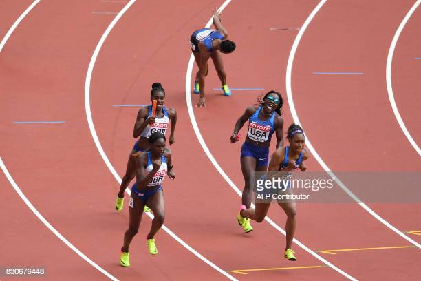 Britain's Dina AsherSmith hands the baton to Britain's Daryll Neita and US athlete Morolake Akinosun hands off to US athlete Ariana Washington in the...