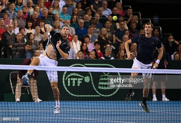 Britain's Dominic Inglot plays a shot as he and Jamie Murray compete against Mike Bryan and Bob Bryan of US during the Davis Cup third round doubles...