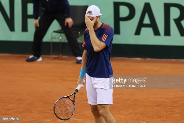 Britain's Dominic Inglot reacts during the tennis match in the world group quarterfinal Davis Cup clash between France and Great Britain at the...