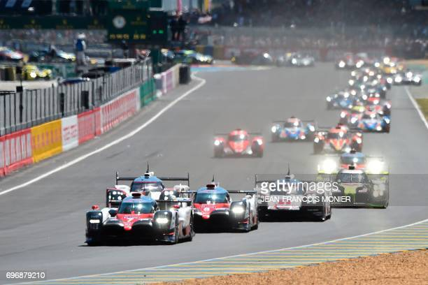 Britain's driver Mike Conway competes on his Toyota TS050 Hybrid N°7 ahead of Switzerland's driver Sebastien Buemi on his Toyota TS050 Hybrid N°8 and...