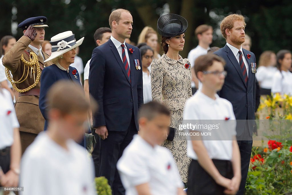 Britain's Duchess Camilla of Cornwall, Britain's Prince William, the Duke of Cambridge, his wife Duchess Catherine of Cambridge, and Britain's Prince Harry stand guard to pay their respect as they attend the memorial ceremony on July 1, 2016, at the Thiepval Memorial in Thiepval, during which Britain and France will mark the 100 years since soldiers emerged from their trenches to begin one of the bloodiest battles of World War I (WWI) at the River Somme. Under grey skies, unlike the clear sunny day that saw the biggest slaughter in British military history a century ago, the commemoration kicked off at the deep Lochnagar crater, created by the blast of mines placed under German positions two minutes before the attack began at 7:30 am on July 1, 1916. / AFP / POOL / Francois Mori