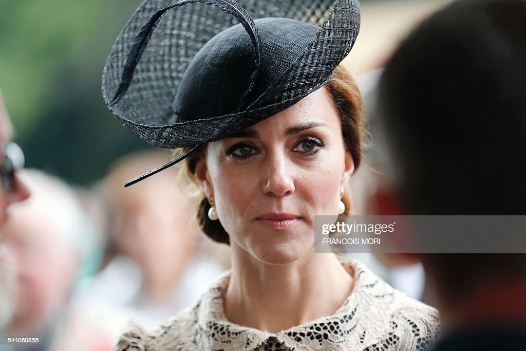 Britain's Duchess Catherine of Cambridge attends the memorial ceremony on July 1, 2016, at the Thiepval Memorial in Thiepval, during which Britain and France will mark the 100 years since soldiers emerged from their trenches to begin one of the bloodiest battles of World War I (WWI) at the River Somme. Under grey skies, unlike the clear sunny day that saw the biggest slaughter in British military history a century ago, the commemoration kicked off at the deep Lochnagar crater, created by the blast of mines placed under German positions two minutes before the attack began at 7:30 am on July 1, 1916. / AFP / POOL / Francois Mori
