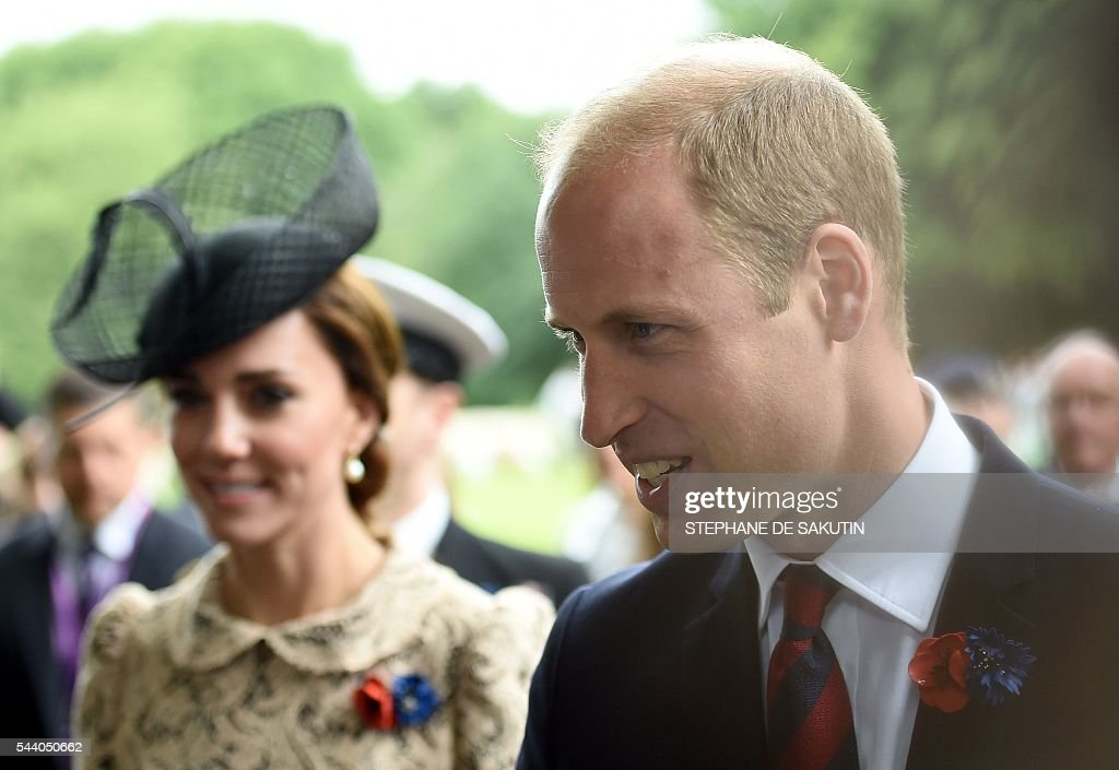 Britain's Duchess of Cambridge Catherine and Britain's Prince Harry attend the memorial ceremony on July 1, 2016, in Thiepval, during which Britain and France will mark the 100 years since soldiers emerged from their trenches to begin one of the bloodiest battles of World War I (WWI) at the River Somme. Under grey skies, unlike the clear sunny day that saw the biggest slaughter in British military history a century ago, the commemoration kicked off at the deep Lochnagar crater, created by the blast of mines placed under German positions two minutes before the attack began at 7:30 am on July 1, 1916. / AFP / STEPHANE