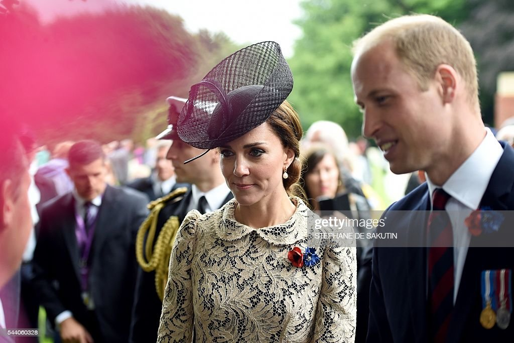 Britain's Duchess of Cambridge Catherine (C) and Britain's Prince William (R) attend the memorial ceremony on July 1, 2016, in Thiepval, during which Britain and France will mark the 100 years since soldiers emerged from their trenches to begin one of the bloodiest battles of World War I (WWI) at the River Somme. Under grey skies, unlike the clear sunny day that saw the biggest slaughter in British military history a century ago, the commemoration kicked off at the deep Lochnagar crater, created by the blast of mines placed under German positions two minutes before the attack began at 7:30 am on July 1, 1916. / AFP / STEPHANE