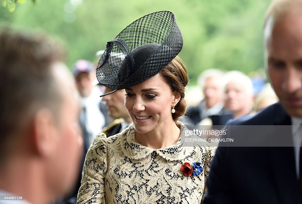 Britain's Duchess of Cambridge Catherine attends the memorial ceremony on July 1, 2016, in Thiepval, during which Britain and France will mark the 100 years since soldiers emerged from their trenches to begin one of the bloodiest battles of World War I (WWI) at the River Somme. Under grey skies, unlike the clear sunny day that saw the biggest slaughter in British military history a century ago, the commemoration kicked off at the deep Lochnagar crater, created by the blast of mines placed under German positions two minutes before the attack began at 7:30 am on July 1, 1916. / AFP / STEPHANE