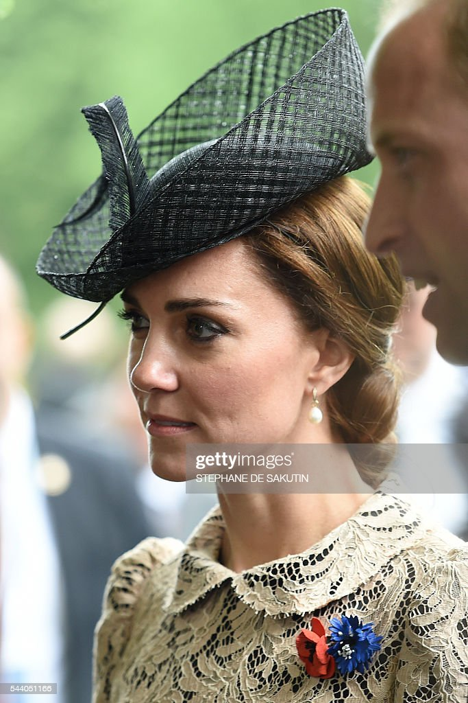 Britain's Duchess of Cambridge Catherine (C) flanked by her husband Britain's Prince William (R), attends the memorial ceremony on July 1, 2016, in Thiepval, during which Britain and France will mark the 100 years since soldiers emerged from their trenches to begin one of the bloodiest battles of World War I (WWI) at the River Somme. Under grey skies, unlike the clear sunny day that saw the biggest slaughter in British military history a century ago, the commemoration kicked off at the deep Lochnagar crater, created by the blast of mines placed under German positions two minutes before the attack began at 7:30 am on July 1, 1916. / AFP / STEPHANE