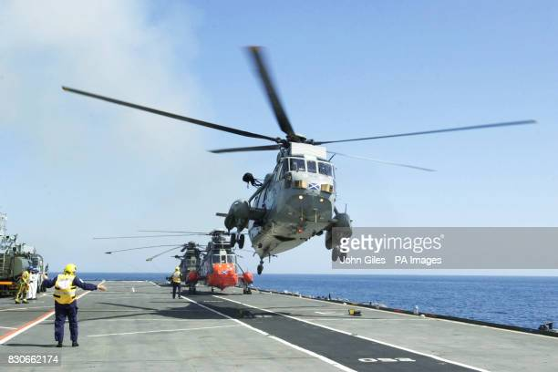 Britain's Duke of York leaves in a Sea King helicopter from the deck of The Ark Royal a Naval ship off Newcastle upon Tyne for the final time as a...