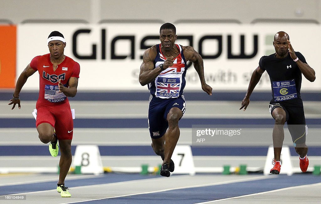 Britain's Dwain Chambers (C) competes in the Men's 60m during The British Athletics Glasgow International Match at The Emirates Arena in Glasgow, Scotland, on January 26, 2013.