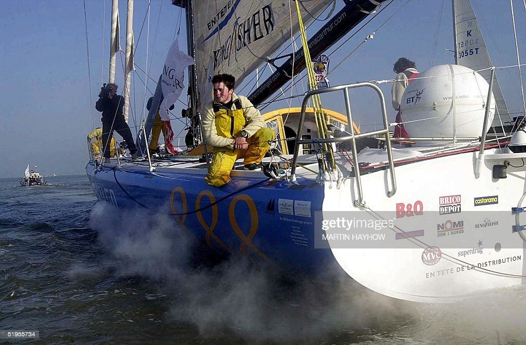 Britain's Ellen Mac Arthur arrives in Southampton Water as smoke pours from her engine unaware that it is about to seize up 15 February 2001 after...