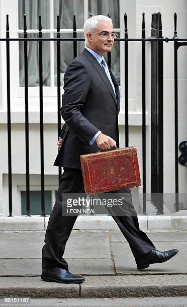 Britain's Finance Minister Alistair Darling walks towards his car after posing for pictures with a briefcase containing the 2009 Budget Report...