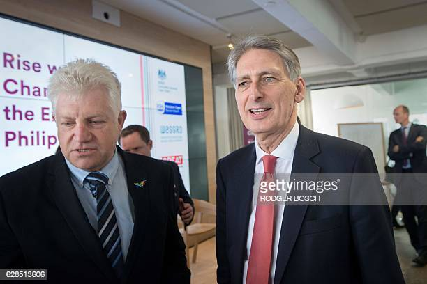 Britain's Finance minister Philip Hammond talks to Western Cape Provincial government Minister of Agriculture Economic Development and Tourism Alan...