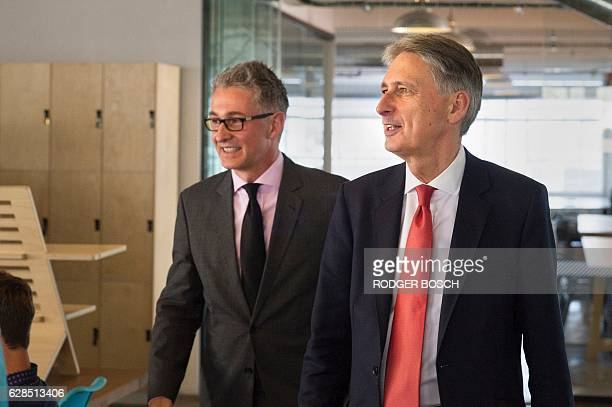Britain's Finance minister Philip Hammond visits Barclays Rise a fintech startup hub on December 8 2016 in Cape Town / AFP / Rodger BOSCH