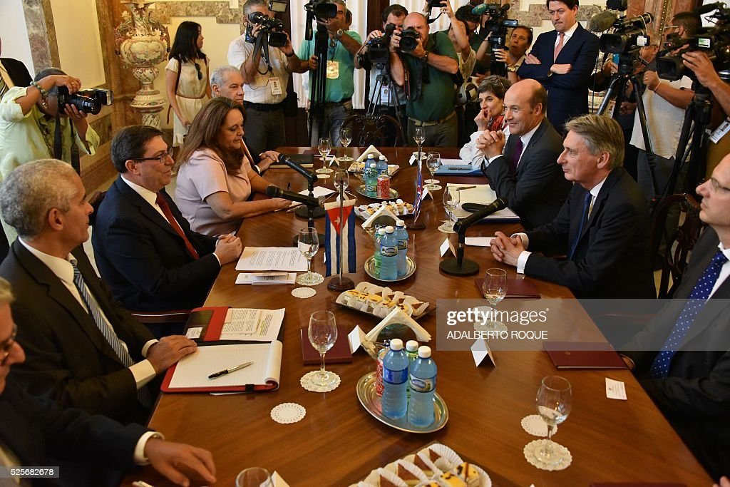 Britain's Foreign Affairs Secretary Philip Hammond (2-R) is welcomed by his Cuban counterpart Bruno Rodriguez (2-L) in the Foreign Affairs Ministry in Havana on April 28, 2016. Hammond arrived in Cuba on Thursday in the first such visit since 1959, to hold talks on cooperation in 'financial services, energy, culture and education', London announced. / AFP / ADALBERTO
