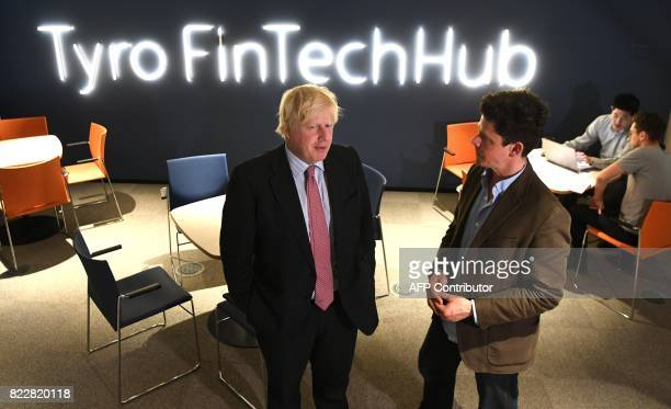 Britain's Foreign Minister Boris Johnson speaks with head of Tyro Fintech Hub Andrew CorbettJones during a visit to the Tyro Fintech technology Hub...