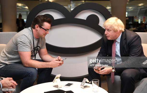 Britain's Foreign Minister Boris Johnson speaks with Iain Griffin CEO of SeatFrog during a visit to the Tyro Fintech technology Hub in Sydney on July...